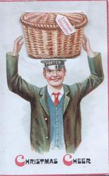 CHRISTMAS CHEER (C's in red) below PORTER carying wicker basket on his head
