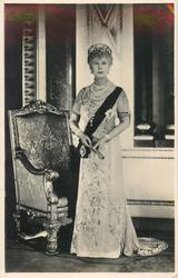 no front title, Queen Mary stands in front of chair facing front
