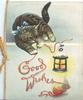 GOOD WISHES in red thread of wool below tabby cat playing with thread, lantern right