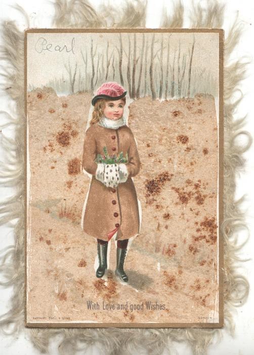 WITH LOVE  AND GOOD WISHES girl stands facing front right, both hands in muff,  in winter  on rural path. glittered