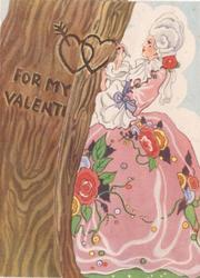 FOR MY VALENTINE woman in old-style dress carves hearts on tree trunk