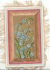 A HAPPY CHRISTMAS blue forget-me-nots over gilt central wooden panel with pale green margins
