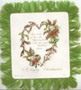 A HAPPY CHRISTMASTIDE below holly & mistletoe on heart shaped trellis front & back