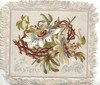 AN EASTER SOUVENIR below passion flowers on thorny rose support