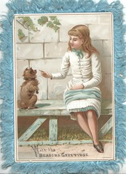 WITH THE SEASON'S GREETINGS below seated girl teaching dog a trick