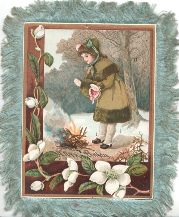 A HAPPY BIRTHDAY below girl warming her hands over a fire in snowy woods, white clematis left & below