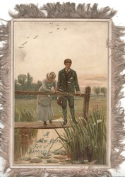 A NEW YEAR FULL OF HAPPINESS in blue below couple standing on plank dock above marsh & reeds, distant birds fly