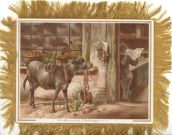 A MERRY CHRISTMAS  donkey   eats apples whilst man stands reading newspaper inside