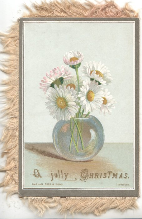 A JOLLY CHRISTMAS below glass bowl of yellow centred white daisies