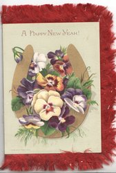 A HAPPY NEW YEAR multicoloured pansies in inverted gilt horseshoe