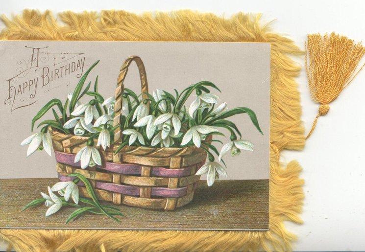 A HAPPY BIRTHDAY upper left, wicker basket of snowdrops below