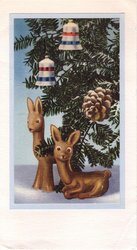 no front title, close view of Christmas tree decorated with 2 bells & pine cone, 2 deer figurines below