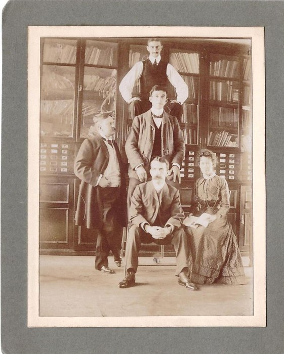 author Grace C. Floyd (sitting right) with members of Raphael House editorial dept., Moorfields London