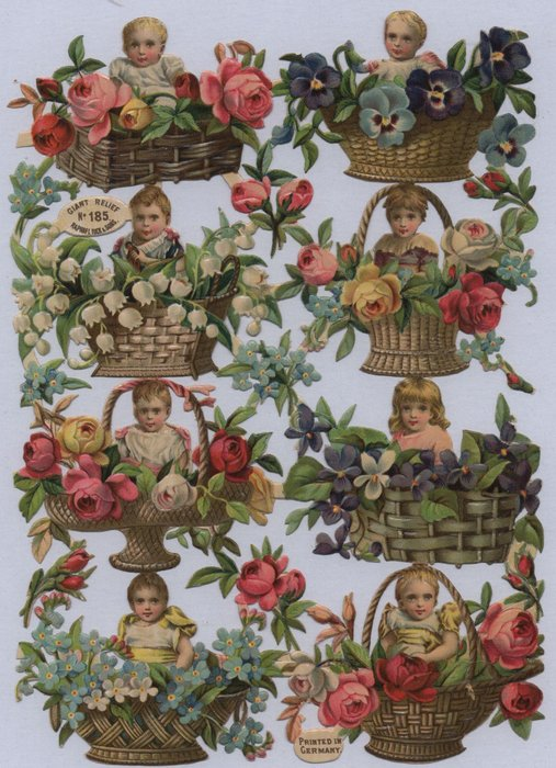 babies and flowers in wicker baskets