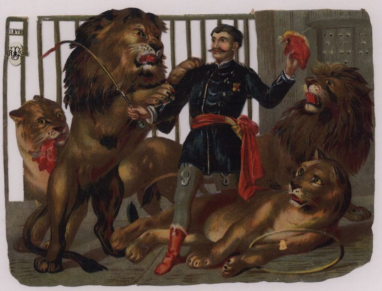 lion tamer with four lions