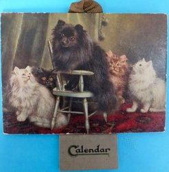 AN HONOURED GUEST, four cats look up at black dog on chair, title on back