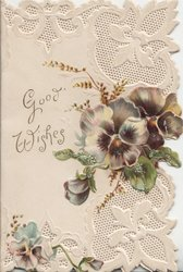 GOOD WISHES left, white & purple pansies right, complex heavily embossed design above & below