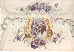 GOOD WISHES (G & W glittered) in gilt at centre on yellow horseshoe, violets around