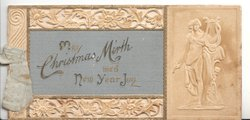 MAY CHRISTMAS MIRTH WED NEW YEAR JOY on grey central plaque, embossed design above & below, sculpture of musician right