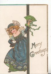 MERRY GREETINGS in gilt(M & G illuninated), girl in blue & green dres stands left holding up floral fan as she comes through door