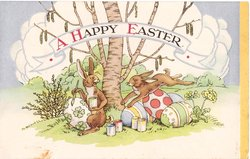 A HAPPY EASTER rabbits & painted Easter eggs, one rabbit paints, the other leaps, yellow panel right