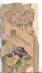 REMEMBRANCE(R illuminated) in gilt on white placard in front of purple pansies against a door & perforated lattice