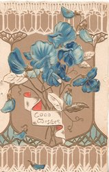 GOOD WISHES in gilt on small plaque under blue sweet peas elaborate gilt perforated design