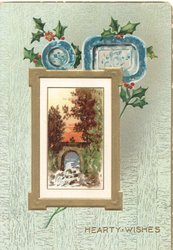 HEARTY WISHES in gilt below blue plates & holly over white & gilt bordered rural inset of bridge, green background