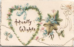 HEARTY WISHES on heart shaped plaque with  forget-me-nots & fern surround, ivy right