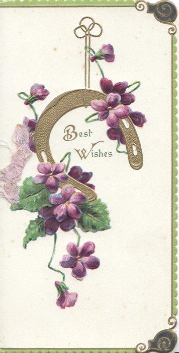 BEST WISHES in gilt framed by gilt horseshoe & violets