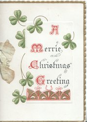 A MERRIE CHRISTMAS GREETING(illuminated) below shamrock leaves above red and gilt design at base