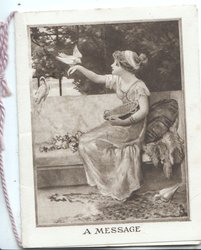A MESSAGE seated pretty girl feeds bird perched on her outstretched hand