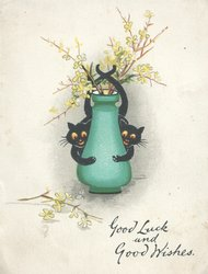 GOOD LUCK  AND GOOD WISHES below 2 black cats clasping green vase of stylised yellow flowers