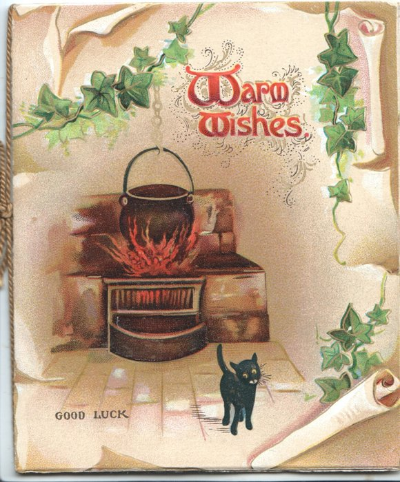 WARM WISHES(W's illuminated)  above pot cooking over fire, small black cat below front, ivy chain around