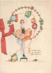 TO WISH YOU A HAPPY CHRISTMAS below girl standing on stool adjusting Japanese lanterns in circular design