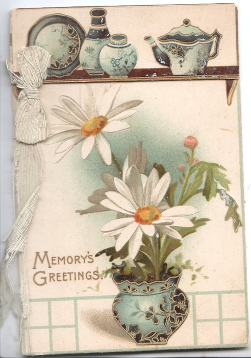 MEMORY'S GREETINGS in gilt yellow centred white daisies in blue pot, more china on shelf above