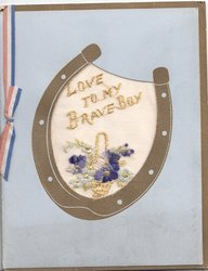 LOVE TO MY BRAVE BOY in gilt on transparent inset in thick card, in gilt horseshoe