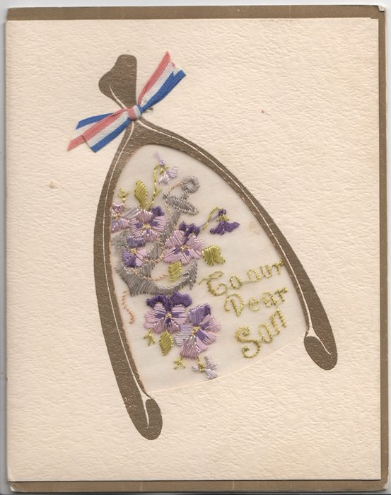TO OUR DEAR SON inset with purple flowers under gilt hoseshoe with red, white & blue ribbon bow
