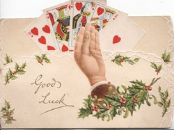 GOOD LUCK in gilt below hand of playing cards(10 to King of Hearts), holly below right