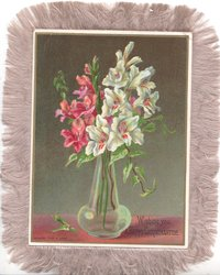 WISHING YOU A HAPPY CHRISTMASTIDE white & purple lilies in pale green glass vase