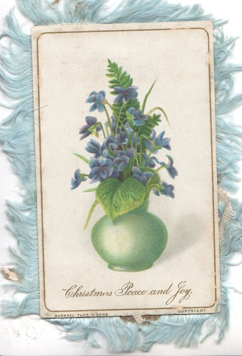 CHRISTMAS PEACE AND JOY below green vase of blue violets, fern frond