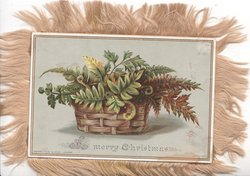 A MERRY CHRISTMAS below ferns in wicker basket