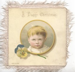 A HAPPY CHRISTMAS above circular inset head & shoulders boy, above pansy