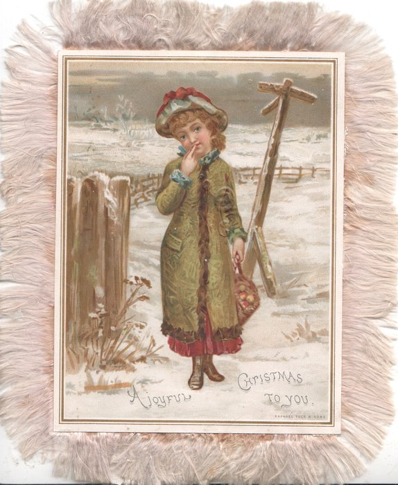 A JOYFUL CHRISTMAS TO YOU girl stands finger to mouth by signpost on a snowy corner