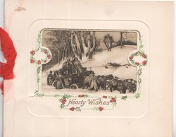 HEARTY WISHES below large window cut revealing A SNOW DRIFT stage coach stuck in snow, berried holly marginal design