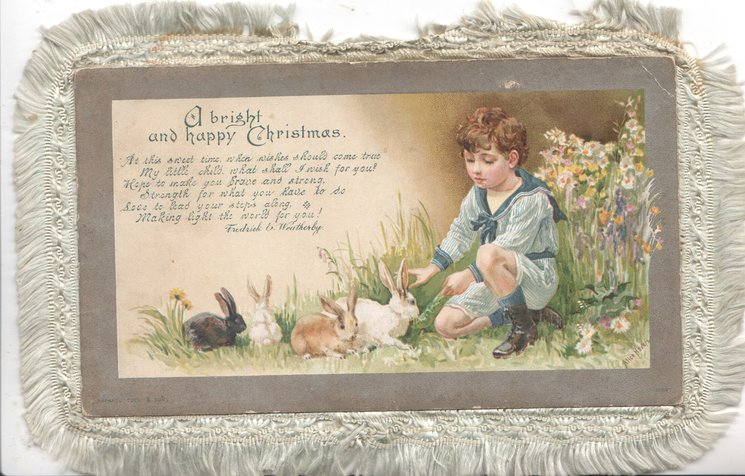 A BRIGHT AND HAPPY CHRISTMAS boy in blue kneels to 4 pet rabbits, verse see below