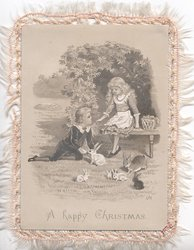 A HAPPY CHRISTMAS  girl seated, boy on ground with tame rabits, rural background
