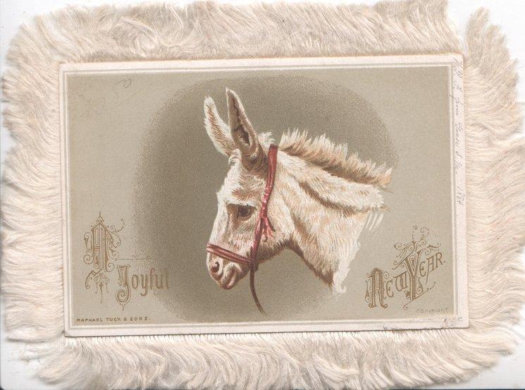 A JOYFUL NEW YEAR head of white donkey facing left
