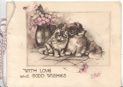 WITH LOVE AND GOOD WISHES kitten & puppy snuggle beside jug of flowers on pavement