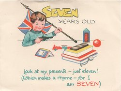 SEVEN in yellow YEARS OLD arms on wall holding flag & pistol, books verse below